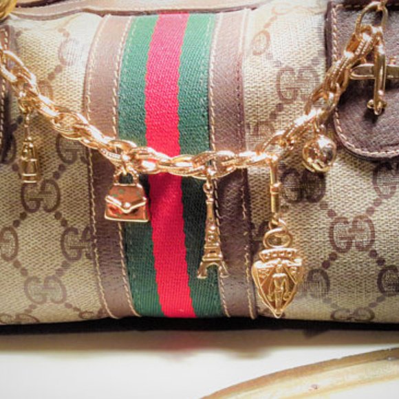 b66500c685df World Traveler theme Bag charm 14k Gucci emblem
